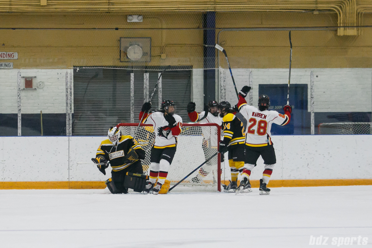 Calgary Inferno players celebrate an Inferno goal