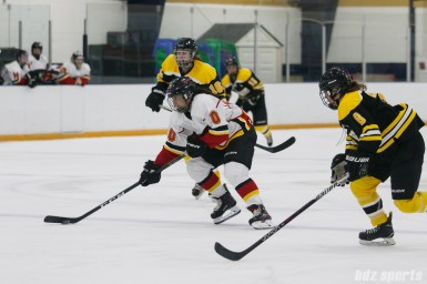 Calgary Inferno forward Rhianna Kurio (10) controls the puck for the Inferno