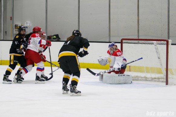 Russian team goalie Mariia Sorokina (69) uses her pad to push the puck away