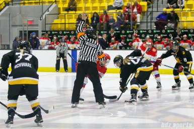 Boston Pride forward Janine Weber (26) takes the face off for the Pride