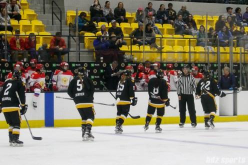 The Boston Pride skate to the bench to celebrate Boston Pride forward Haley Skarupa's (22) goal