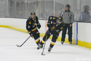 Boston Pride forward Emily Field (15) controls the puck for the Pride