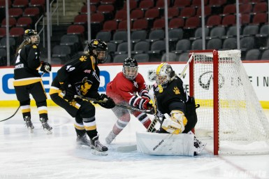 Boston Pride goalie Brittany Ott (29) comes up with a glove save