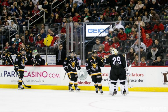 Boston Pride defender Meagan Mangene (57) high fives teammate Brittany Ott (29) after scoring a goal in the third period