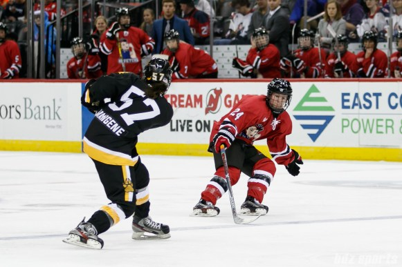 Metropolitan Riveters forward Harrison Browne (24) defends against Boston Pride defender Meagan Mangene (57)