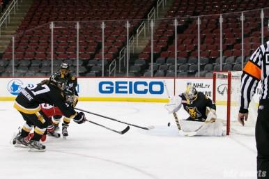Boston Pride goalie Brittany Ott (29) makes a save against Metropolitan Riveters forward Miye D'Oench's (19) shot on goal