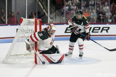 Team Canada goalie Genevieve Lacasse (31) makes a stop