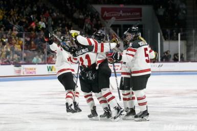 Team Canada celebrates Laura Fortino's (8) second period goal