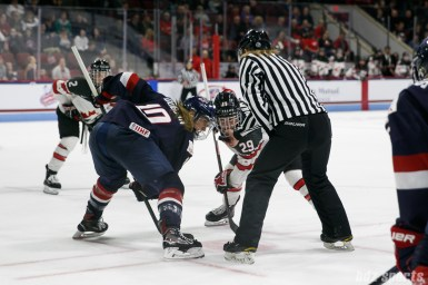 Team USA forward Meghan Duggan (10) faces off against Team Canada forward Marie-Philip Poulin (29)