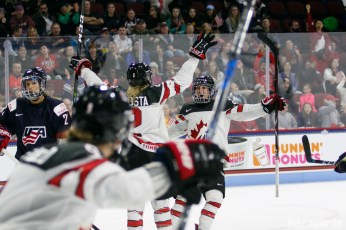 Team Canada captain Marie-Philip Poulin (29) celebrates teammate Meghan Agosta's (2) goal