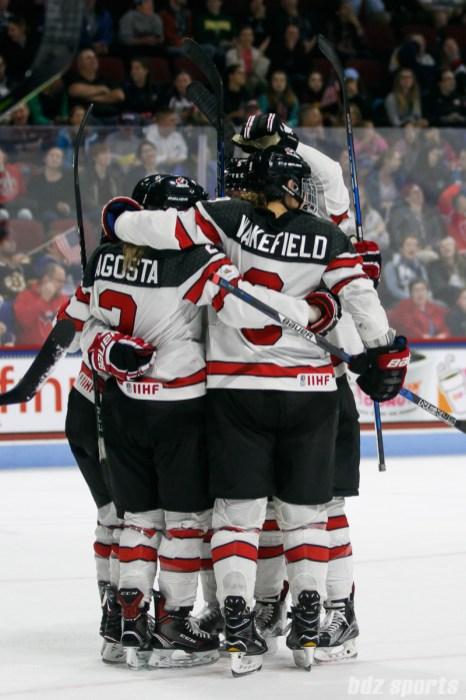 Team Canada celebrates their fourth goal of the game