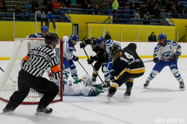 Connecticut Whale goalie Sydney Rossman (34) attempts to cover a loose puck in front of the net