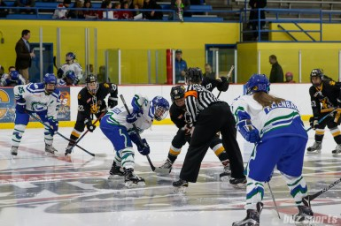 Connecticut Whale forward Jamie Goldsmith (12) and Boston Pride forward Corey Stearns (9) face off