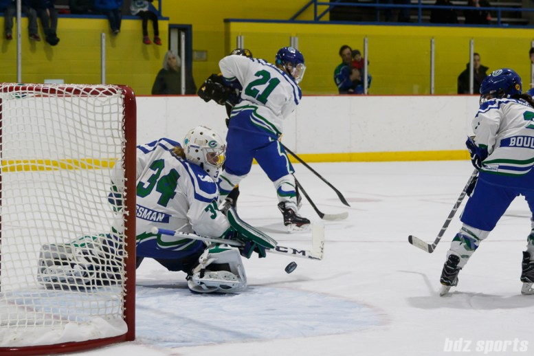 Connecticut Whale goalie Sydney Rossman (34) pushes the puck wide of the goal