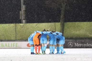The FC Twente starting XI huddle before the start of the game