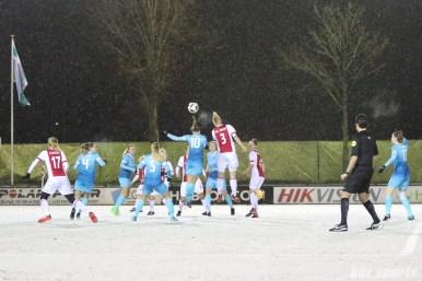 Ajax defender Stefanie van der Gragt (3) heads the ball over FC Twente midfielder Jassina Blom (10)