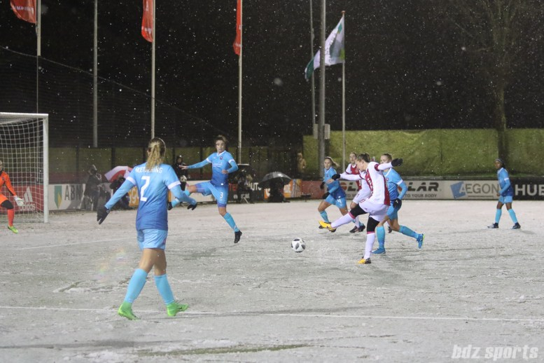 Ajax midfielder Desiree van Lunteren (10) takes a shot on goal