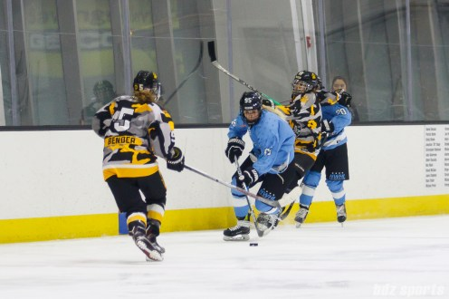 Buffalo Beauts forward Taylor Accursi (95) carries the puck down ice