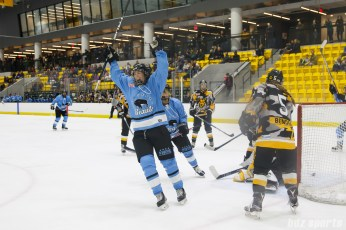 Buffalo Beauts forward Rebecca Vint (12) celebrates scoring the game's first goal and the first goal of her NWHL career
