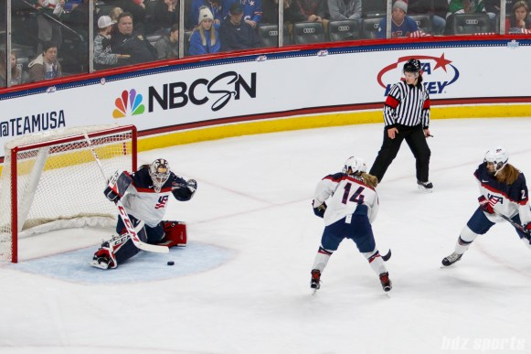 Team USA goalie Maddie Rooney (35) stretches out to come up with the save