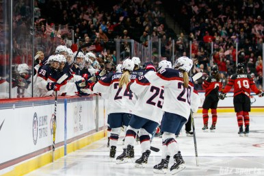 Team USA players high five the bench after Megan Keller's goal in the second period