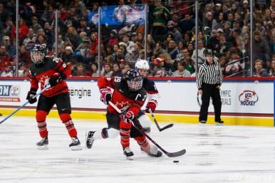 Team Canada forward Marie-Philip Poulin (29) controls the puck for Team Canada