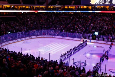 Players and fans stand for the playing of the national anthem prior to the USA vs Canada game on December 3, 2017