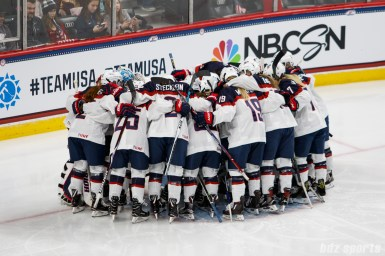 Team USA huddles before the start of the Time is Now Tour USA vs Canada game in St. Paul, MN on December 3, 2017