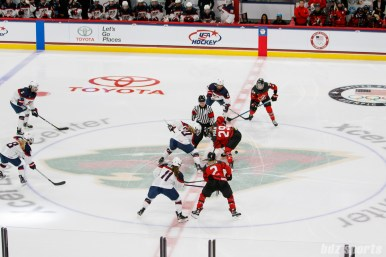 Team USA forward Hannah Brandt (20) and Team Canada forward Marie-Philip Poulin (29) take the face off to start the game