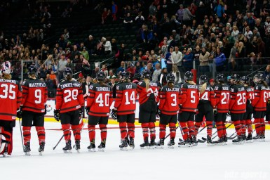 Team Canada line up at the end of the game for the awarding of team player of the game