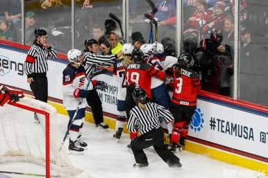 A scuffle breaks out between Team USA and Team Canada players in the first period