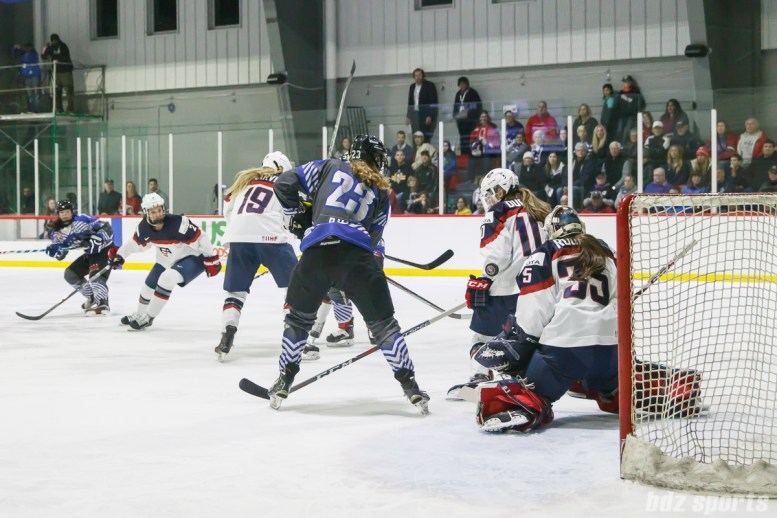 Team USA goalie Maddie Rooney (35) looks to collect the puck in front of the goal