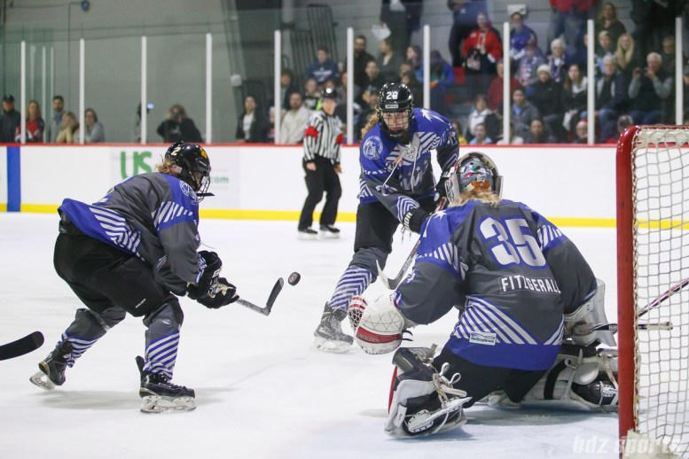 Team NWHL defender Alyssa Gagliardi (2) looks to clear the puck out of danger