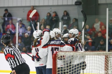 Team USA celebrates forward Jocelyne Lamoureux-Davidson's (17) goal in the third period
