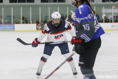 Team USA forward Kelly Pannek (12) prepares to take the face off