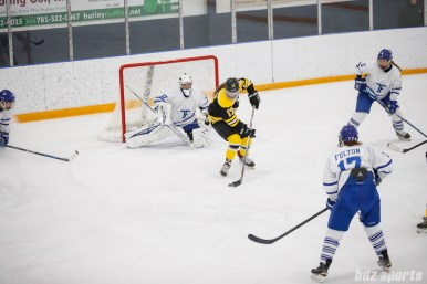 Boston Blades forward Meghan Grieves (17) finds herself open in front of Toronto Furies goalie Sonja van der Bliek (30)