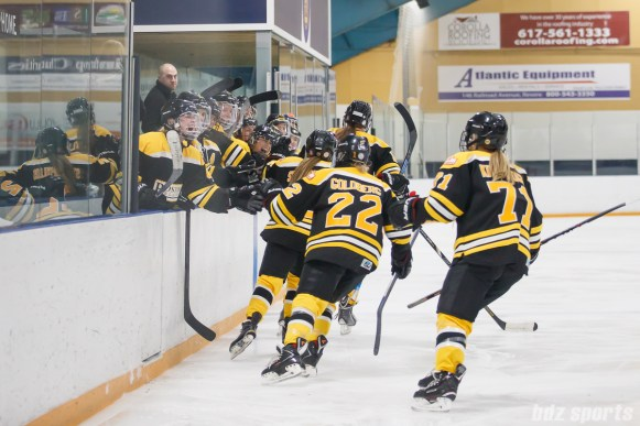 Boston Blades players high five the bench