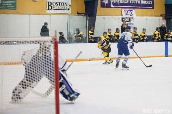 Boston Blades forward Megan Myers (15) takes a shot on net