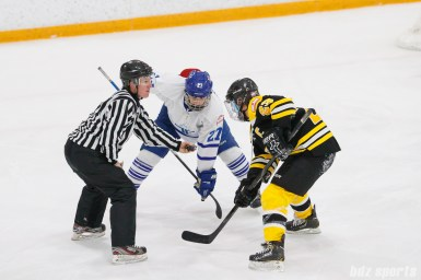 Toronto Furies forward Carolyne Prevost (27) takes the face off against Boston Blades forward Melissa Bizzari (23)