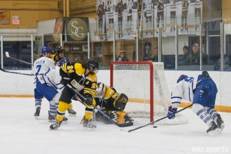 The puck is loose in front of the Boston Blades' goal