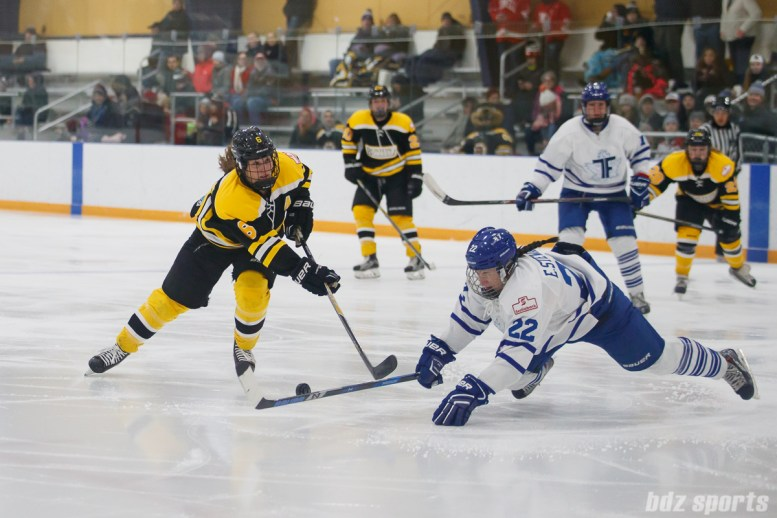 Toronto Furies defender Ella Stewart (22) dives to block the shot from Boston Blades forward Erin Kickham (6)
