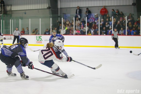 Team USA forward Hannah Brandt (20) takes a shot on goal