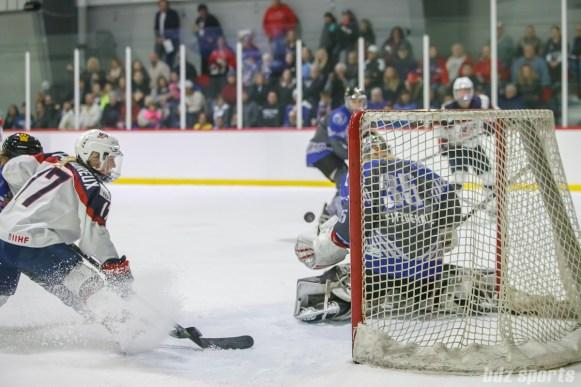 Team NWHL goalie Katie Fitzgerald (35) stops the puck