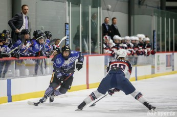 Team NWHL forward Dana Trivigno (17) looks to get past Team USA defender Kacey Bellamy (22)