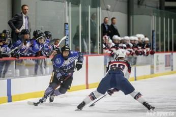 Team NWHL forward Dana Trivigno (17) looks to get past Team USA defender Kacey Bellamy (22)