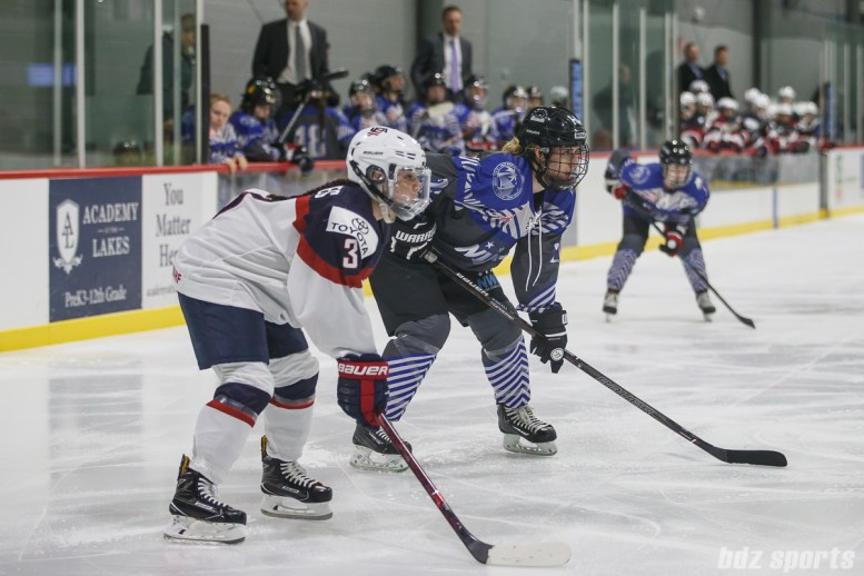 Team USA defender Cayla Barnes (3) and Team NWHL forward Hayley Scamurra (24) line up during a faceoff