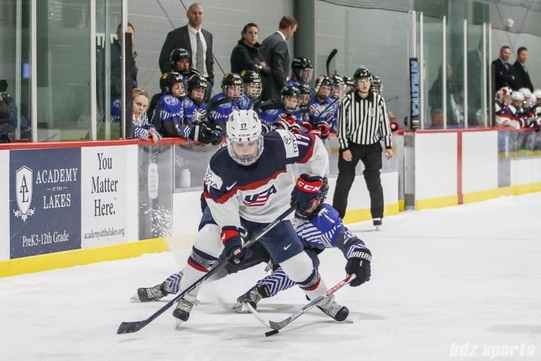 A Team NWHL player looks to stuff the puck against Team USA forward Jocelyne Lamoureux-Davidson (17)