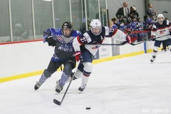 Team NWHL forward Jordan Smelker (11) battles Team USA defender Kacey Bellamy (22) for the puck