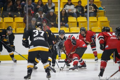 Boston Pride forward Jordan Smelker (11) takes the faceoff against Metropolitan Riveters forward Alexa Gruschow (11)