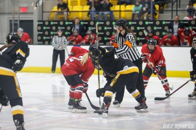 Metropolitan Riveters forward Erika Lawler (2) and Boston Pride forward Corey Stearns (9) take the opening faceoff
